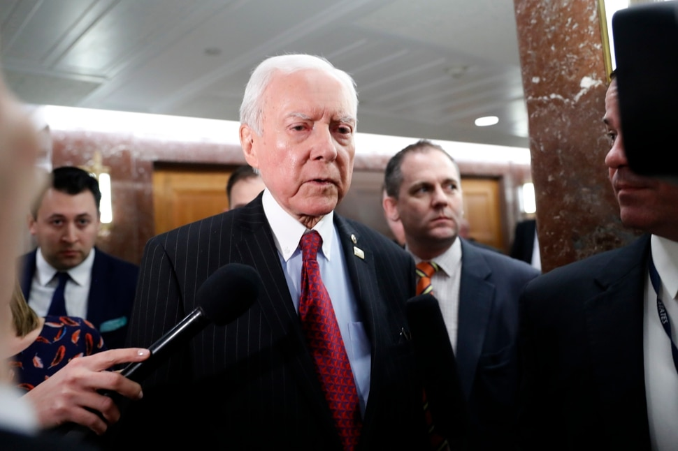 Senate Health, Education, Labor, and Pensions Committee member Sen. Orrin Hatch, R-Utah, center, leaves the committee's executive session on Education Secretary-designate Betsy DeVos, Tuesday, Jan. 31, 2017, on Capitol Hill in Washington. (AP Photo/Alex Brandon)