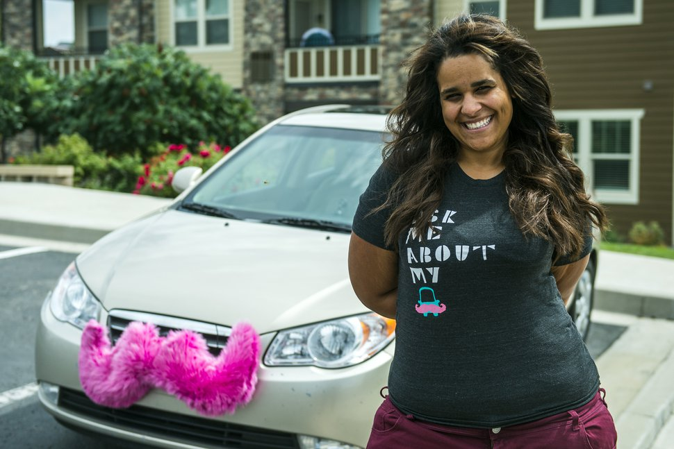 (Chris Detrick | Tribune file photo) Angie Palmer Maynard poses for a portrait with her car in Midvale, Aug. 7, 2014, after Salt Lake City hit her with two $6,500 tickets as an early Lyft driver for picking up passengers at the airport without being a licensed taxi driver.