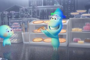 """(Image courtesy of Disney/Pixar) The spirit of jazz musician Joe Gardner, right (voiced by Jamie Foxx), tries to show an unfinished soul, 22 (voiced by Tina Fey) about the joy of New York pizza, in a scene from the animated film """"Soul."""""""