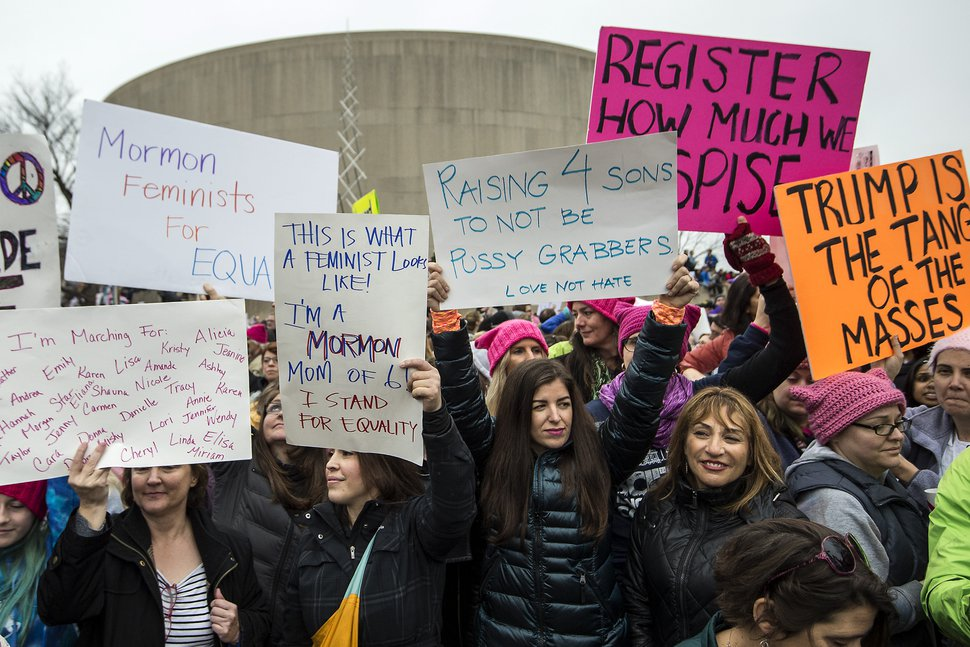 Chris Detrick | The Salt Lake Tribune (L-R) Lisa James, of Rockville, Md., Emily Olsen, of Falls Church, Va., Lena Schwen, of Alexandria, Va., and Ronna Miranda, of Naples, Florida, participate the Women's March on Washington at the National Mall Saturday January 21, 2017.
