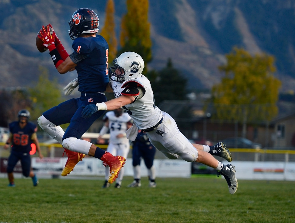 (Scott Sommerdorf | The Salt Lake Tribune) Brighton WR Simi Fehoko catches this pass during second half play. Brighton beat Syracuse 35-14 in a 5A first-round playoff game at Brighton, Friday, October 31, 2014.