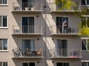 (Trent Nelson  |  The Salt Lake Tribune) A man on the balcony of a Salt Lake City apartment, on Tuesday, April 21, 2020. Utahns who spend more than 50% of their income on rent often find it hard to pay the rest of their bills, buy groceries or fill their car's gas tank. Help is available from the government, local nonprofits and advocacy groups.
