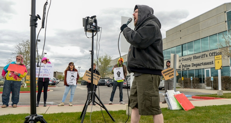 Leah Hogsten | The Salt Lake Tribune Jacob Jensen with Utah Against Police Brutality rallies demonstrators outside the Salt Lake County Sheriff's office prior to Unified Police Department's public hearing, April 10, 2019 on whether its officers should continue wearing body cameras. Utah Against Police Brutality were demanding that the council move to equip every UPD officer in the field with a body-cam to protect all the people they interact with, for both principled and practical reasons.