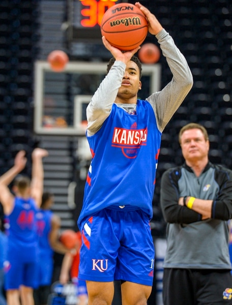 Leah Hogsten | The Salt Lake Tribune Kansas Jayhawks guard Devon Dotson (11) takes a shot under the eye of head coach Bill Self during practice on Wednesday. The Kansas Jayhawks take the court during the 2019 NCAA Division I Men's Basketball Championship, March 20, 2019 in preparation for their first round game against the Northeastern Huskies on Thursday.