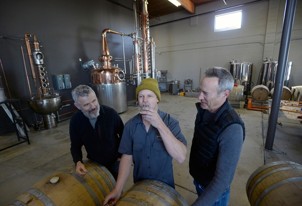 (Al Hartmann | The Salt Lake Tribune) Matt Aller, left, Chris Barlow, and Erik Ostling, co-owners of Beehive Distilling sample Barrel Reserve Gin at their new Salt Lake City location, 2245 S. West Temple. The new 450-gallon copper still in the background will allow for increased production.