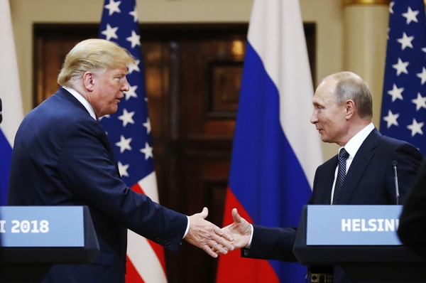 FILE In this file photo taken on Monday, July 16, 2018, U.S. President Donald Trump shakes hand with Russian President Vladimir Putin at the end of the press conference after their meeting at the Presidential Palace in Helsinki, Finland. Pavel Palazhchenko was a constant presence as chief interpreter for Soviet leader Mikhail Gorbachev and Foreign Minister Eduard Shevardnadze, and watched from Moscow to see how the latest chapter in the US-Soviet story would unfold. During an interview Monday July 23, 2018, Palazchenko declined to call the latest Helsinki meeting between US President Trump and Russian President Putin an outright failure, but said there seems a lack of clarity on exactly what the two agreed on. (AP Photo/Alexander Zemlianichenko, File)