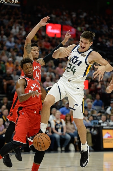 (Francisco Kjolseth | The Salt Lake Tribune) Utah Jazz guard Grayson Allen (24) battles Toronto Raptors guard Kyle Lowry (7) in the first half of the preseason NBA game at Vivint Smart Home Arena Tuesday, Oct. 2, 2018, in Salt Lake City.