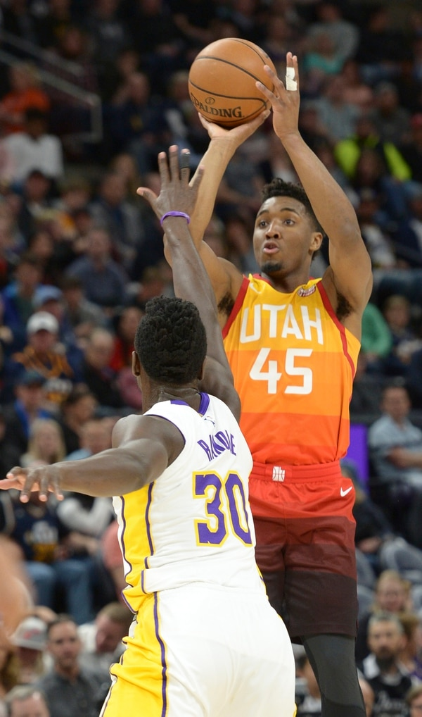 (Leah Hogsten | The Salt Lake Tribune) Utah Jazz guard Donovan Mitchell (45) hits a 3-point shot over Los Angeles Lakers forward Julius Randle (30) as the Utah Jazz host the Los Angeles Lakers at Vivint Smart Home Arena Tuesday, April 3, 2018