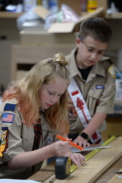 (Francisco Kjolseth | The Salt Lake Tribune) Miriam Cook, 11, helps her brother Kolbie, 12, with his Eagle Scout project as they assemble bird houses in the family garage in Tooele on Monday, May 14, 2018. Miriam, who is one of the early adopters into the Cub Scouts, has always been interested in the things her brother did in Scouting and has a goal of earning her Arrow of Light — the bridge from Cub Scouts to Boy Scouts (which will be called Scouts BSA after February).