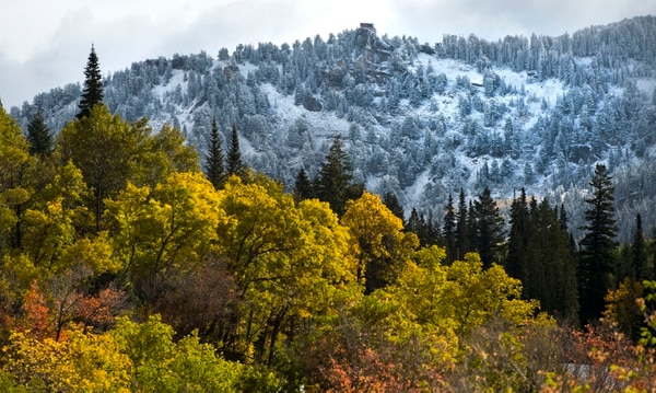 (Steve Griffin / Tribune file photo) A fresh dusting of snow covers the mountain tops in Little Cottonwood Canyon merging fall and winter in September 2016.