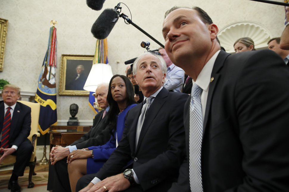 President Donald Trump, left, sits with Sen. Orrin Hatch, R-Utah, Rep. Mia Love, R-Utah, Sen. Bob Corker, R-Tenn., and Sen. Mike Lee, R-Utah, as they meet with Joshua Holt, who was recently released from a prison in Venezuela, in the Oval Office of the White House, Saturday, May 26, 2018, in Washington. (AP Photo/Alex Brandon)