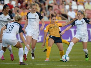 (Francisco Kjolseth  |  The Salt Lake Tribune)  Utah Royals FC midfielder Veronica Boquete (21) gets caught up in the competition as Utah Royals FC hosts the North Carolina Courage at Rio Tinto Stadium in Sandy, Utah on Saturday, July 27, 2019.