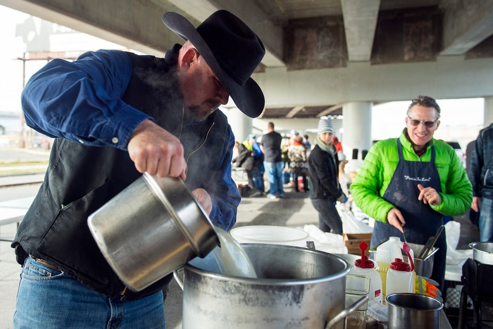 (Chris Detrick   The Salt Lake Tribune) Eagles Ranch Ministries chaplain Eric Burson makes stuffing during the Eagle Ranch Chuckwagon under the viaduct at 500 South and 600 West in Salt Lake City Thursday, November 23, 2017.