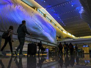 (Leah Hogsten | The Salt Lake Tribune) Travelers walk through Salt Lake City International Airport, Mar. 13, 2021.