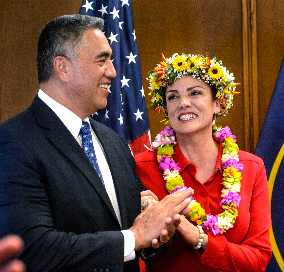 (Steve Griffin | The Salt Lake Tribune) Michelle Kaufusi smiles at her husband Steve Kaufusi after taking the Oath of Office, administered by Judge Vernon Romeny, as she becomes the first female mayor in Provo city's history. The small private ceremony was held in the Mayor's Office in Provo Tuesday January 2, 2018. A public Inauguration Ceremony for Mayor Kaufusi will be held at the Provo Library on January 18, 2018.