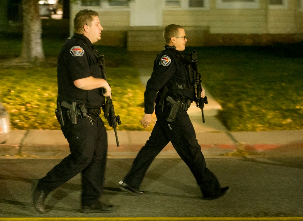 (Rick Egan   The Salt Lake Tribune) Police officers move into position, as they search for an active shooter on the University of Utah campus, near Red Butte Garden, in Salt Lake City, Monday, October 30, 2017.
