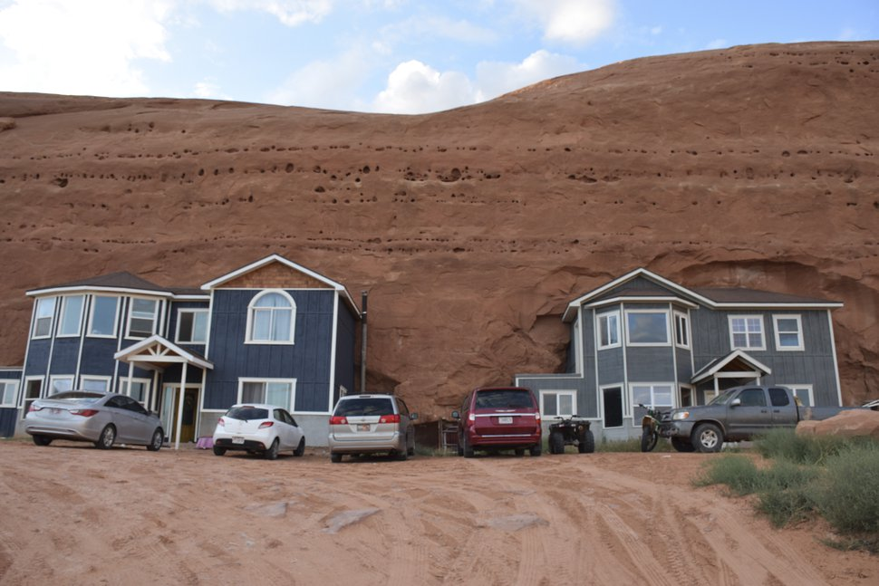 (Shannon Mullane for High Country News) The Fosters and other families blasted holes in sandstone before filling them with suburban-style homes at Rockland Ranch.