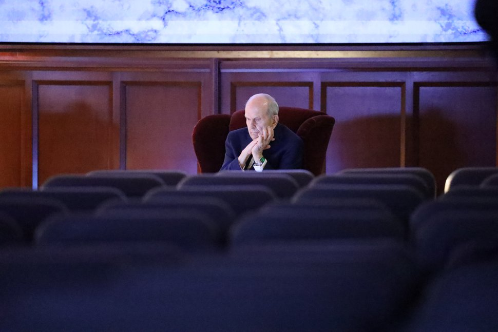(Photo courtesy of The Church of Jesus Christ of Latter-day Saints) Church President Russell M. Nelson, in a virtually empty auditorium at the Church Office Building, watches conference proceedings on a monitor April 4, 2020.
