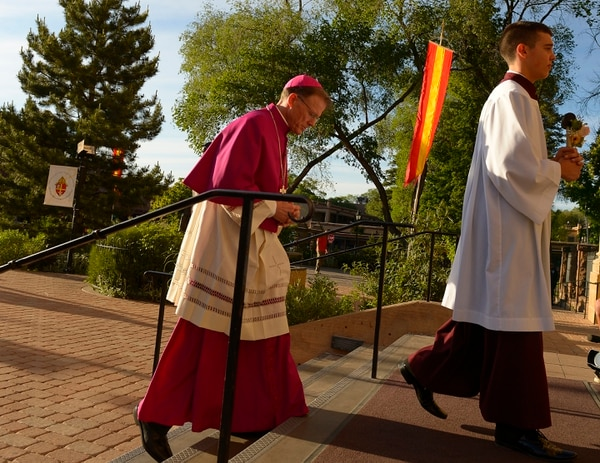 Leah Hogsten | The Salt Lake Tribune Archbishop John C. Wester walks to the entrance to the Cathedral Basilica of St. Francis of Assisi in Santa Fe, Wednesday, June 3, 2015, to knock three times on the door in a symbol of the Rite of Reception of the Archbishop in his Cathedral Church.