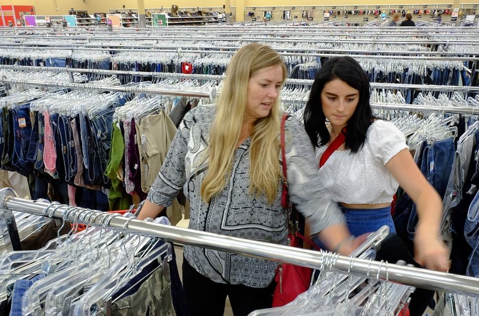 (Francisco Kjolseth | The Salt Lake Tribune) Mother-daughter duo Nancy and Shivani Lindmeir comb through the racks of a Savers thrift store in Salt Lake City recently in search of possible vintage gems. The pair decided to push their passion for vintage clothing when they created The Thrill of a Thrift. For the past three years they have curated clothing from 1920 to 1990 selling their wares on Etsy, and have been staying busy searching for enough inventory to fill their booth as one of the exhibitors at Craft Lake City this weekend.