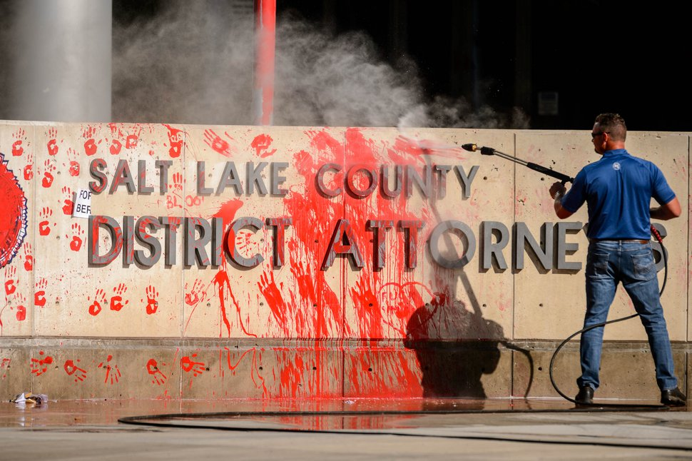 (Trent Nelson   The Salt Lake Tribune) After last night's protest, workers wash off paint at the Salt Lake County District Attorney's office in Salt Lake City on Friday, July 10, 2020.