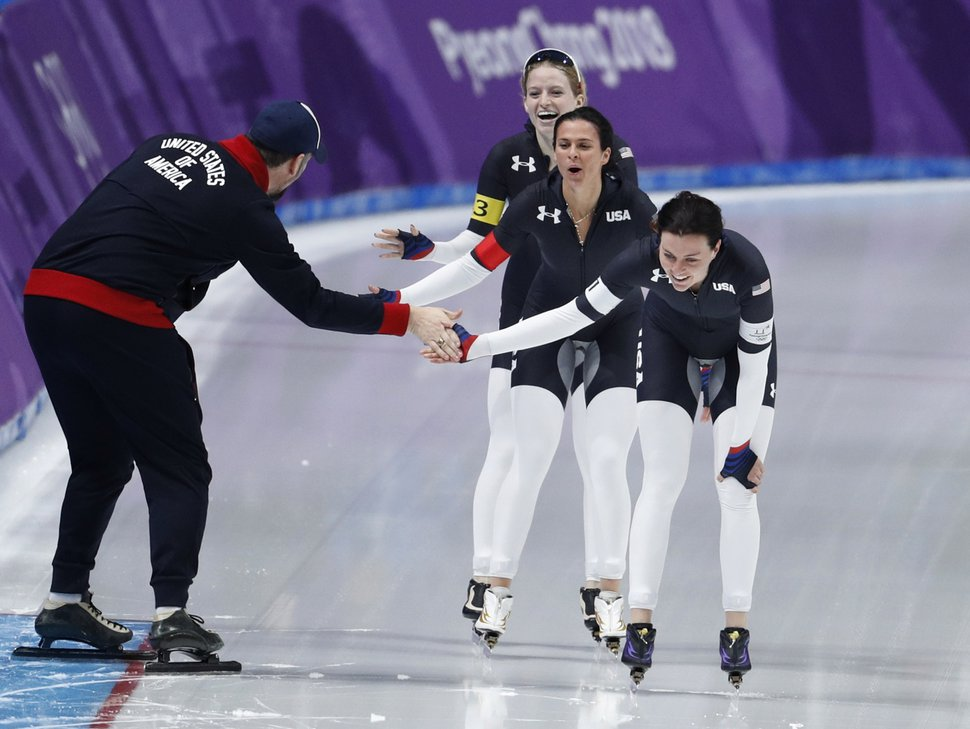Team U.S.A. with Heather Bergsma, front, Brittany Bowe, center, and Mia Manganello, rear, celebrates with their coach after the quarterfinals of the women's team pursuit speedskating race at the Gangneung Oval at the 2018 Winter Olympics in Gangneung, South Korea, Monday, Feb. 19, 2018. (AP Photo/John Locher)