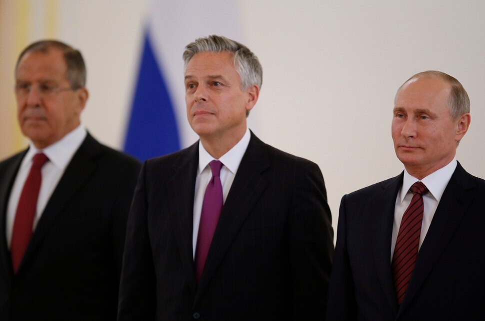 Russian President Vladimir Putin, right, smiles receiving credentials from the U.S. Ambassador, Jon Huntsman, center, during a ceremony in the Kremlin in Moscow, Russia, on Tuesday, Oct. 3, 2017. The new U.S. Ambassador to Russia presented his credentials to President Vladimir Putin in the Kremlin on Monday amid investigations into Moscow's meddling in the 2016 U.S. elections. Russian Foreign Minister Sergey Lavrov is at left. (AP Photo/Pavel Golovkin, Pool)
