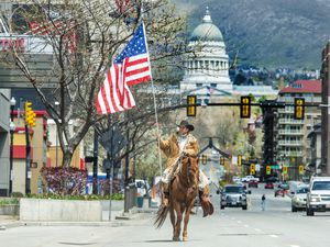 (Rick Egan | Tribune file photo) Couy Griffin from New Mexico rides his horse down State Street in Salt Lake City, Thursday, April 16, 2020. Griffin was arrested Jan. 17, 2021 on charges of illegally entering the U.S. Capitol on Jan. 6.