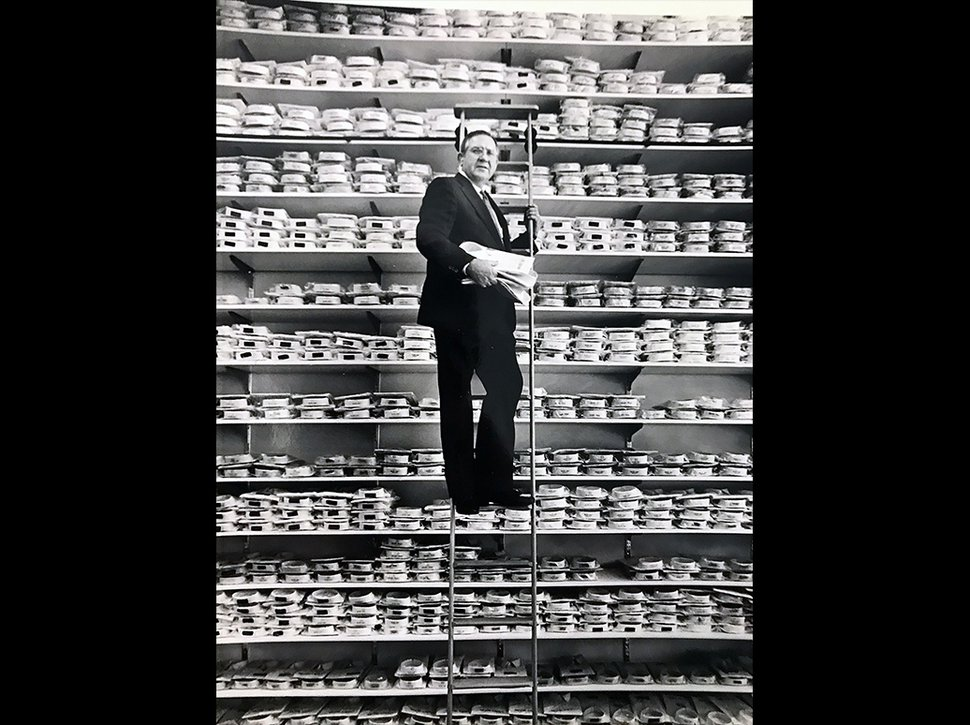 (Tim Kelly | Tribune file photo) Mac Christensen, the man behind the Mr. Mac clothing stores, poses on a ladder along shelves of dress shirts in the spring of 1990 in what was then his new store at 135 S. Main in Salt Lake City.