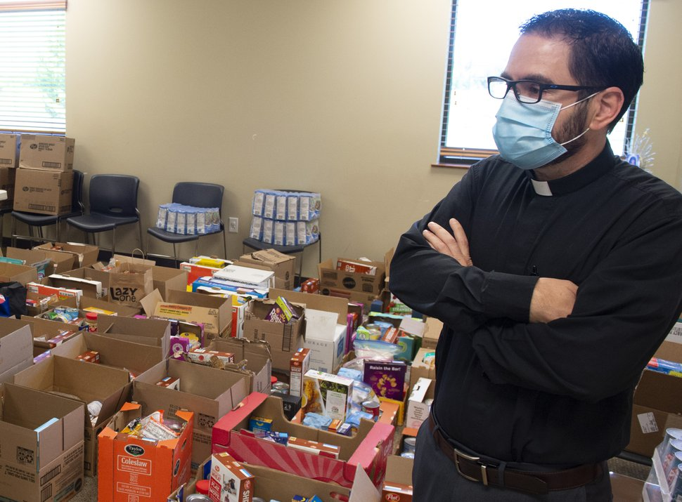 (Rick Egan | The Salt Lake Tribune) The Rev. Rogelio Felix-Rosas shows one of the rooms full of food that has been donated to St. Thomas Aquinas Catholic Church, which is supporting more than 50 families impacted by the COVID-19 outbreak at the JBS Beef Plant in Hyrum, Thursday, June 18, 2020.