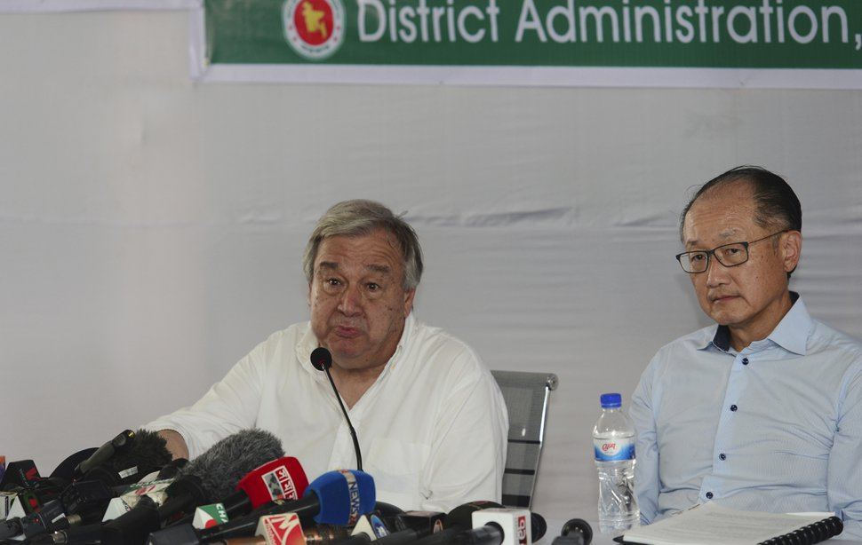 U.N. Secretary General Antonio Guterres speaks as World Bank President Jim Yong Kim looks on during a press conference at the Kutupalong refugee camp in Cox's Bazar district, Bangladesh, Monday, June 2, 2018. Guterres said Monday that he heard