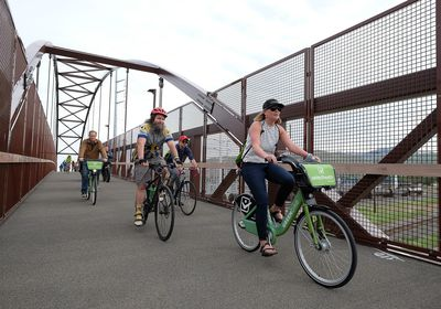 (Francisco Kjolseth     The Salt Lake Tribune)  People join Salt Lake City Mayor Jackie Biskupski on Thursday, May 16, 2019, as part of the annual Mayor's Bike to Work Day. This year's ride began at the Northwest Recreation Center and ran primarily along the Jordan River Trail in an effort to show off the investments the city and others have made to the trail including the new 120-foot arch bridge that connects the north and south sides of the trail between 200 South and North Temple.