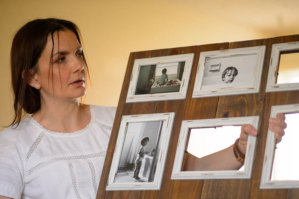 (Trent Nelson | The Salt Lake Tribune) Michelle Densley with photographs of her children in her apartment in Salt Lake County on Monday April 8, 2019.