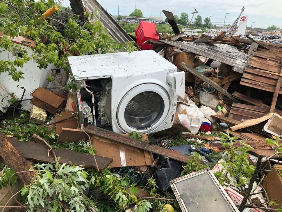 (Summer Ballentine | AP) Debris from a home that David Surprenant rents with his family is scattered across the lawn Thursday, May 23, 2019, the morning after a tornado hit Jefferson City, Mo. Surprenant said his family fled to the basement while he watched the sky outside. Officials are going door-to-door to survey damage after a tornado ripped a 3-mile path through Missouri's capital city. The destruction in Jefferson City was part of an outbreak of severe weather overnight.