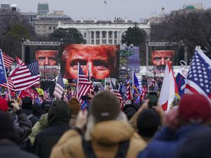 """FILE - In this Jan. 6, 2021, file photo, Trump supporters participate in a rally in Washington. Far-right social media users for weeks openly hinted in widely shared posts that chaos would erupt at the U.S. Capitol while Congress convened to certify the election results. Selena Gomez is laying much of the blame for the violent attack on the U.S. Capitol at the feet of Big Tech. The singer told the leaders of Facebook, Twitter, Google and YouTube that they've allowed """"people with hate in their hearts"""" to thrive and therefore """"failed all the American people."""" It's just the latest in the 28-year-old Gomez's efforts to draw attention to the dangers of internet companies. In an exclusive interview with The Associated Press, Gomez explains why she's so passionate about the issue and what she's done both publicly and behind the scenes to get her message across. (AP Photo/John Minchillo, File)"""