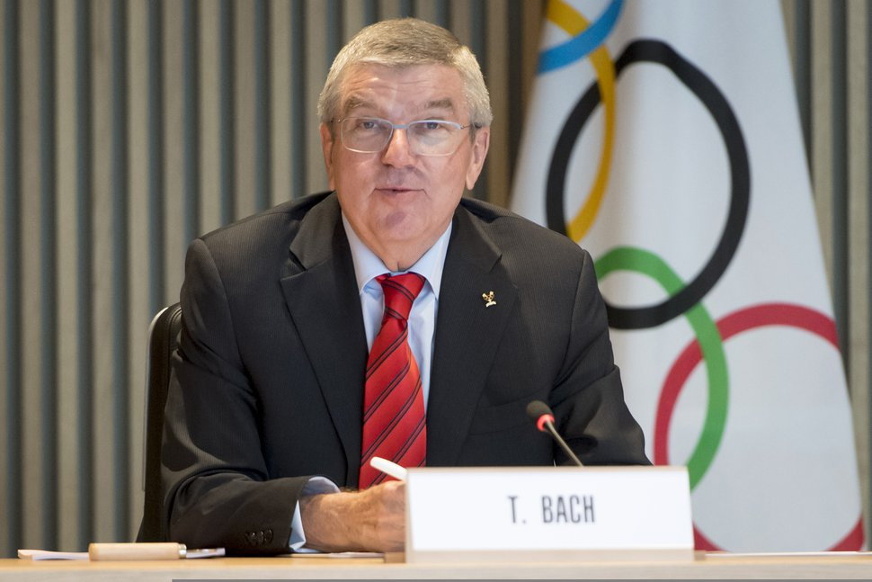 (Laurent Gillieron/Keystone via AP) International Olympic Committee (IOC) president Thomas Bach, center, from Germany, speaks at the opening of the executive board meeting of the International Olympic Committee (IOC) at the Olympic House, in Lausanne, Switzerland, Wednesday, Oct. 2, 2019.