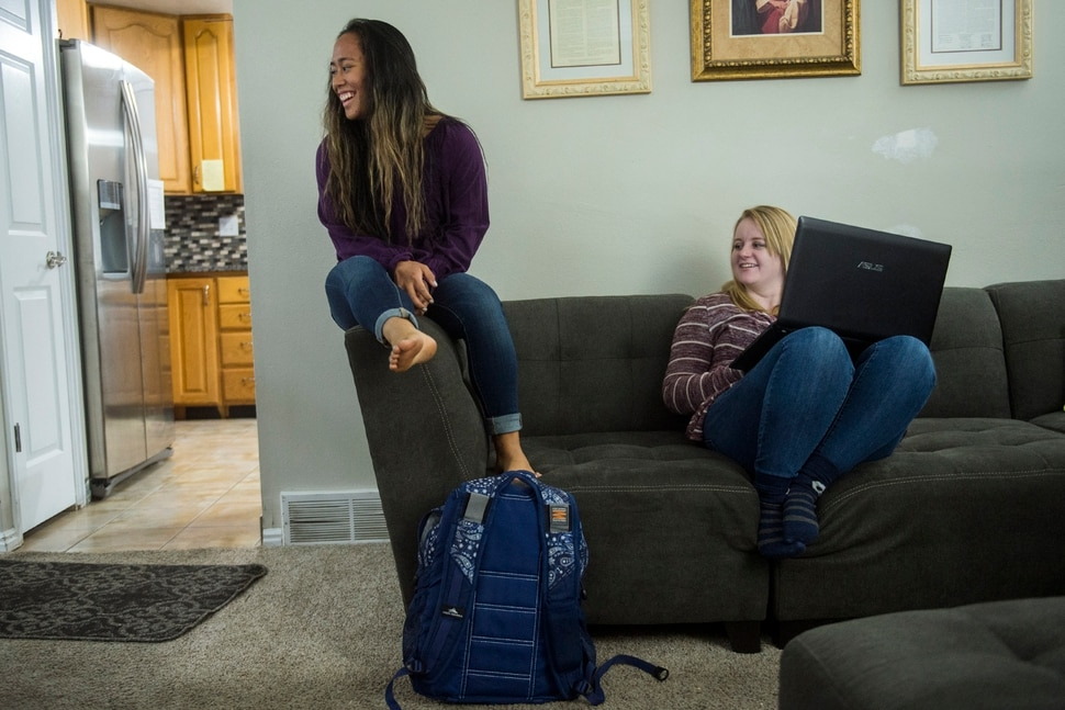 (Chris Detrick | The Salt Lake Tribune) Amanda Badham, 23, and Divina Badham, 16, at their home in Farmington Thursday, November 2, 2017.