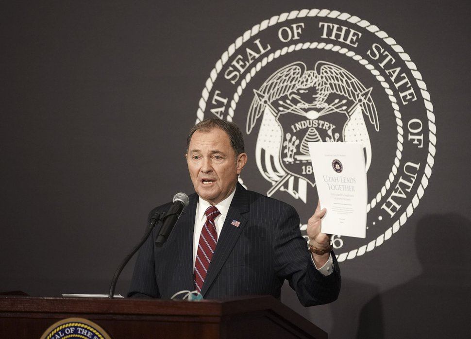 Utah Gov. Gary Herbert holds up the