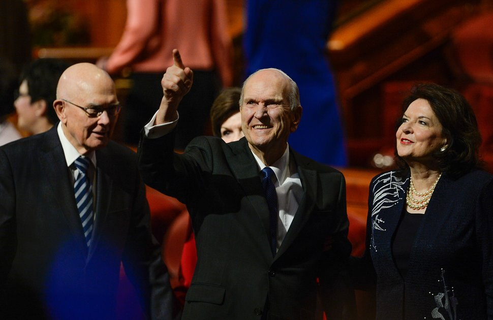 (Francisco Kjolseth | The Salt Lake Tribune) President Russell M. Nelson waves to the crowd as he and his wife, Wendy Nelson, exit at the conclusion of the Sunday morning session of the 189th Semiannual General Conference of The Church of Jesus Christ of Latter-day Saints at the Conference Center in Salt Lake City on Sunday, Oct. 6, 2019. At left is President Dallin H. Oaks, first counselor in the First Presidency.