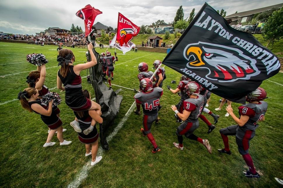 Trent Nelson | The Salt Lake Tribune Layton Christian takes the field for their home opener, hosting Duchesne, high school football in Layton Thursday August 21, 2014.