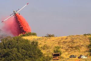 (Steve Griffin  |  The Salt Lake Tribune)  as planes drop fire retardant on a burning ridgeline  above homes in Bountiful Tuesday August 29, 2017.