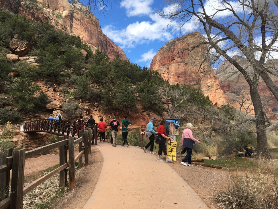 (Photo courtesy Zion National Park) In this photo posted to the Zion National Park Facebook page on March 25, 2020, hikers stand and walk along a trail in the park. Rangers have encouraged visitors to practice social distancing to reduce coronavirus infections.