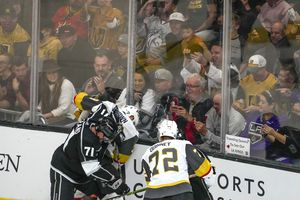(Leah Hogsten   The Salt Lake Tribune) Fans try to get photos of a scrum as the Los Angeles Kings and Vegas Knights meet in a preseason game at Vivint Arena on Sept. 30, 2021.
