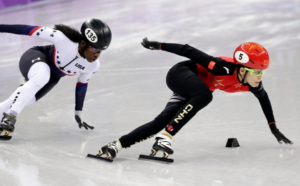 Kexin Fan of China leads Maame Biney of the United States in their ladies' 500 meters short-track speedskating heat in the Gangneung Ice Arena at the 2018 Winter Olympics in Gangneung, South Korea, Saturday, Feb. 10, 2018. (AP Photo/David J. Phillip)