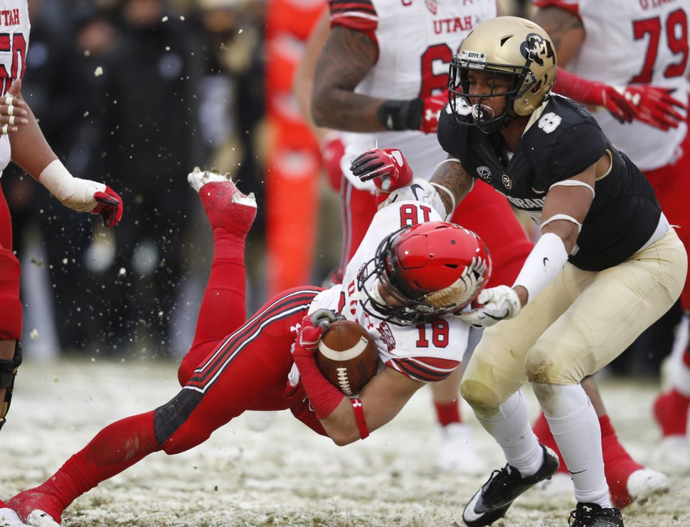 Colorado special teams player Trey Udoffia, right, drags down Utah punt returner Britain Covey as he returns a punt in the second half of an NCAA college football game Saturday, Nov. 17, 2018, in Boulder, Colo. Utah won 30-7. (AP Photo/David Zalubowski)