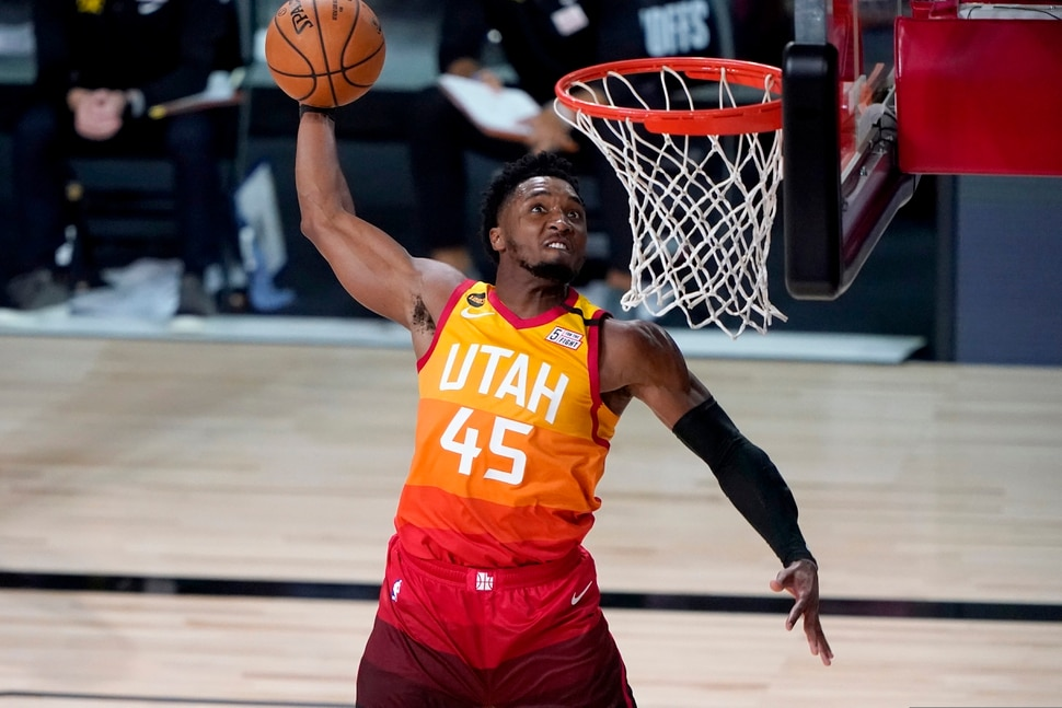 Utah Jazz's Donovan Mitchell (45) dunks against the Denver Nuggets during the second half of an NBA basketball first round playoff game Friday, Aug. 21, 2020, in Lake Buena Vista, Fla. (AP Photo/Ashley Landis, Pool)