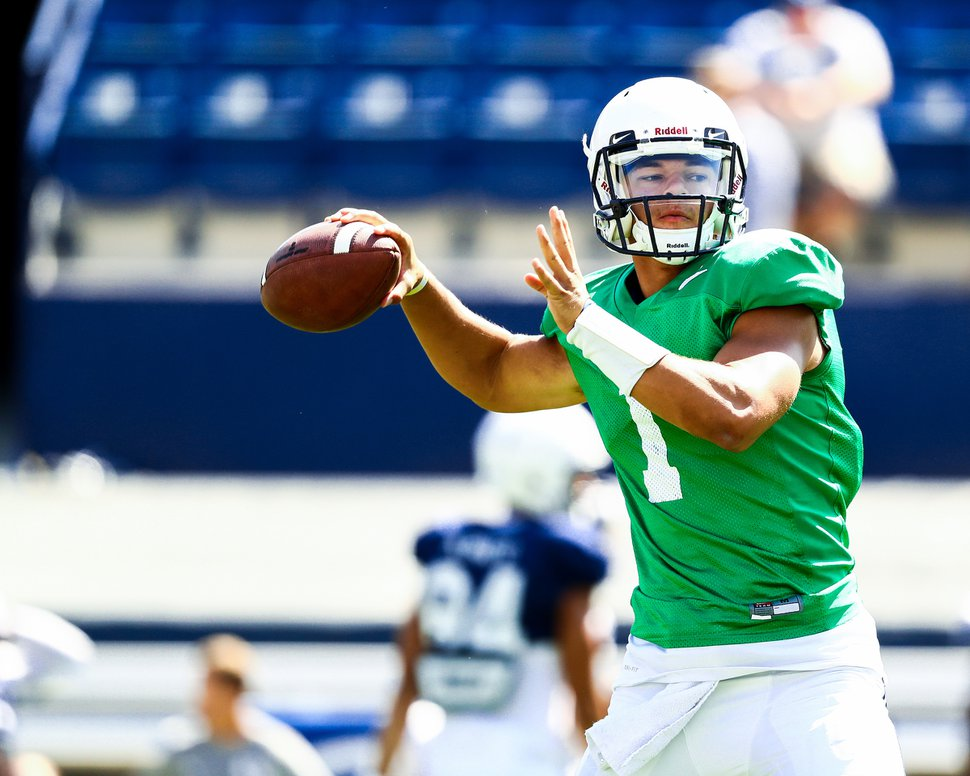(Photo courtesy of Jaren Wilkey, BYU photo) BYU quarterback Jaren Hall, shown here warming up before a scrimmage on Aug. 15, 2018, will also play baseball for the Cougars this spring.