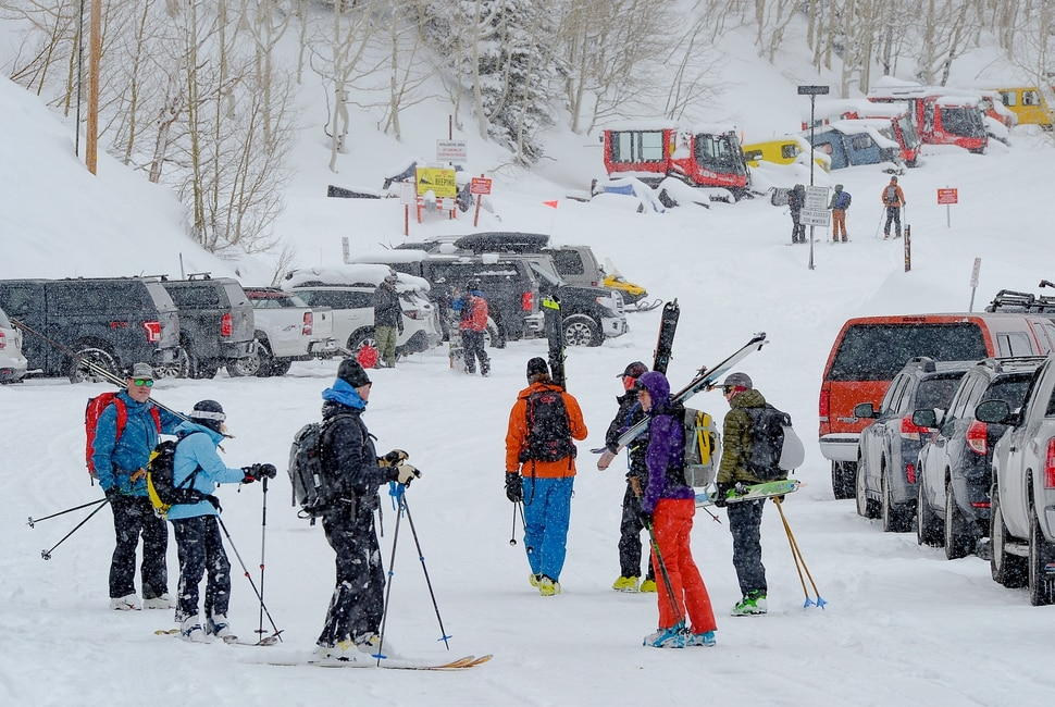 (Francisco Kjolseth | The Salt Lake Tribune) With all the resorts closed due to the coronavirus pandemic, skiers are taking advantage of new snowfall by turning to uphill skiing, as crowds come and go along the Summer Road by Alta Ski Resort on Wednesday, March 25, 2020 with regular discussions of maintaining social distancing. So far Alta has allowed uphill traffic on some of its terrain but closed on Wednesday for avalanche control. There has also has been a run on people buying backcountry gear, and skins for skis are nearly impossible to find.