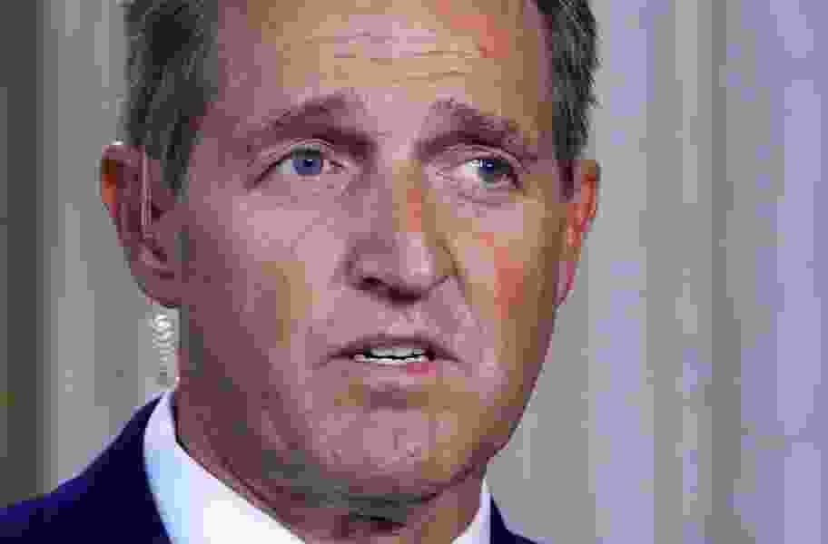 Republican Sen. Jeff Flake sends Democrat Doug Jones a check for Alabama Senate campaign