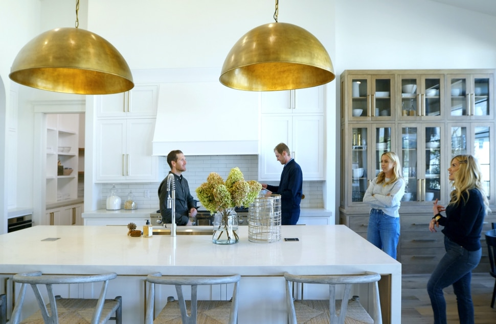 (Photo courtesy of Netflix) Syd McGee (left), Shea McGee (right) and two of their clients in Dream Home Makeover.